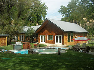 Imagine a family vacation in your own log cabin, with a mile of private riverfront. 3 bedroom 2 bath home for vacation rental in Idaho!